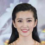 李冰冰白色礼服出席首映会